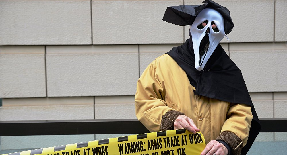 A demonstrator from 'Stop G8' is pictured outside the offices of BAE Systems in London on June 12, 2013, during a protest against the G8 Summit.