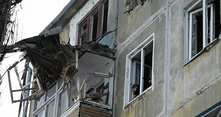 A residential building damaged by an attack of the Ukrainian armed forces in Donetsk
