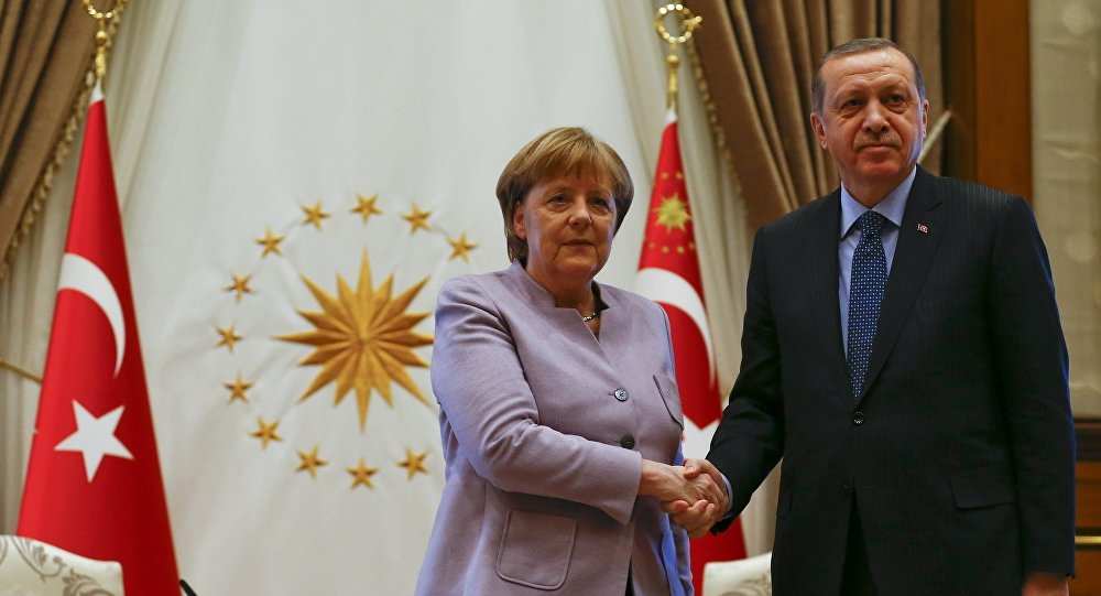 Turkish President Recep Tayyip Erdogan and German Chancellor Angela Merkel exchange a handshake at the presidential palace during the first visit since July's failed coup in Ankara, Turkey, February 2, 2017.