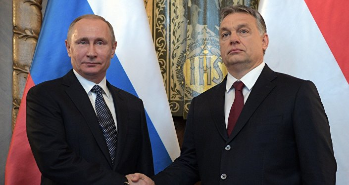 Hungarian Prime Minister Viktor Orban (R) and Russian President Vladimir Putin attend a news conference following their talks in Budapest, Hungary