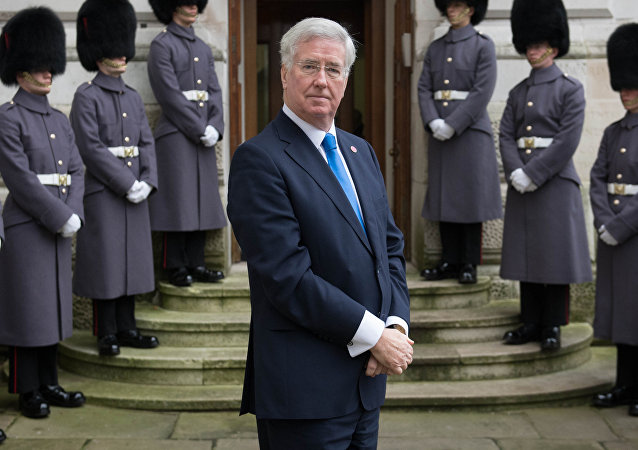 Britain's Defense minister Michael Fallon waits outside the Foreign Office on December 15, 2016 in London.