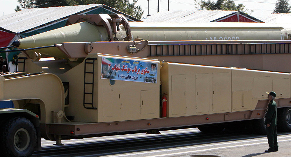 A member of Iranian Corps Guards of the Islamic Revolution forces looks at a Shahab 3 missile during large-scale military parades in Tehran (File)