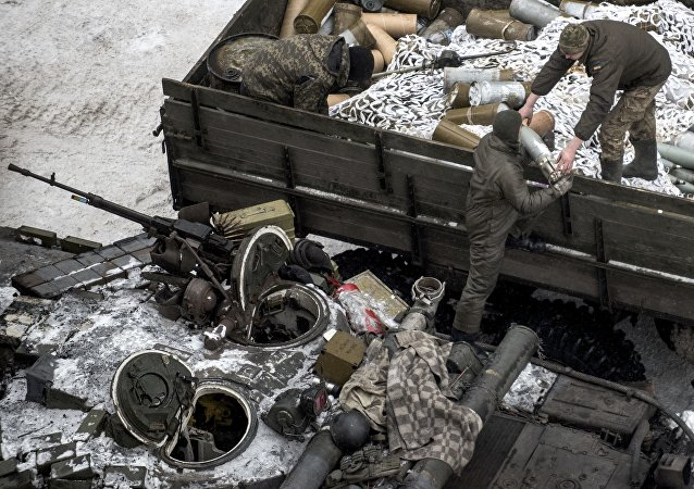 Ukrainian servicemen load ammunition into a tank in Avdiivka, eastern Ukraine, Thursday, Feb. 2, 2017
