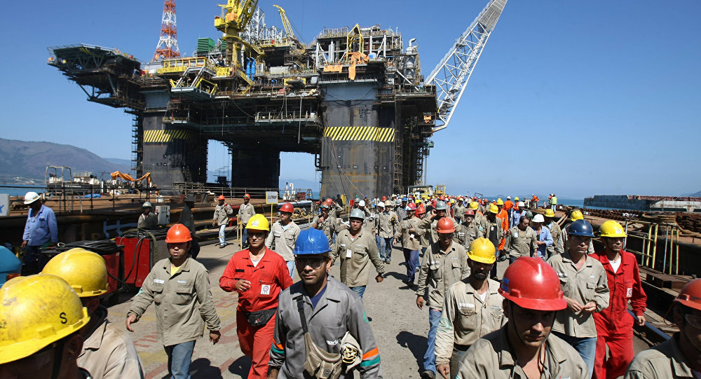 A whole shift of workers leave at lunchtime the Petrobras P-51 semi-submersible off-shore oil platform construction site at the Brasfelf shipyard in Angra dos Reis, 180 km south of Rio de Janeiro, Brazil (File)