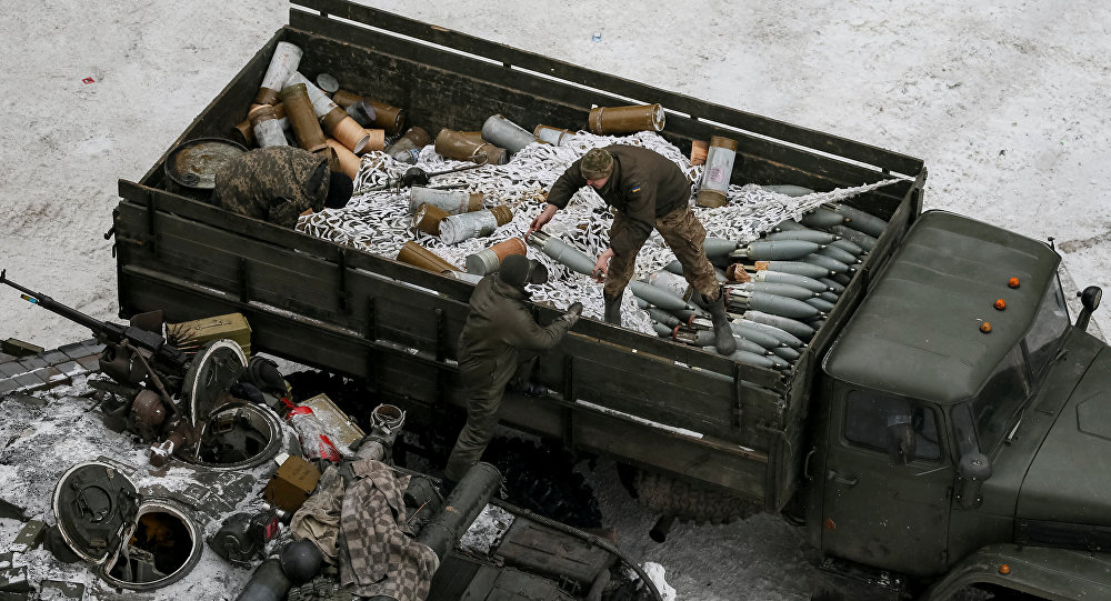 Crew members prepare tanks in the government-held industrial town of Avdiyivka, Ukraine, February 2, 2017