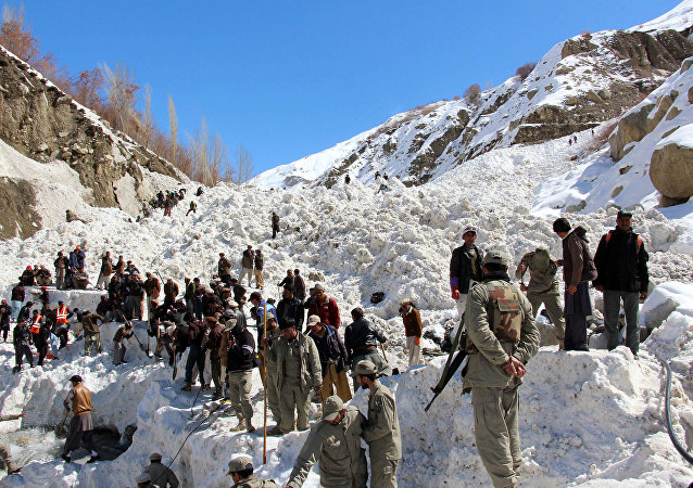 (File) Pakistani paramilitary soldiers and residents search for missing victims following an avalanche in Susom village, some 40 kilometres north of the town of Chitral in Khyber Pakhtunkhwa province on March 22, 2016