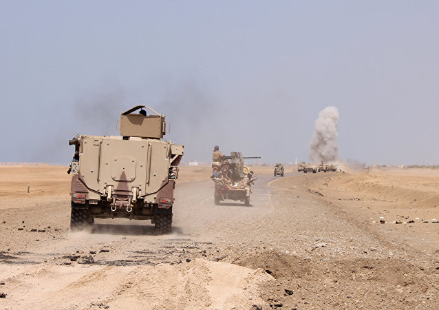 (File) Smoke rises as a Yemeni military armoured personnel carrier was hit by a Houthi rocket near the Red Sea coast city of al-Mokha, Yemen January 23, 2017