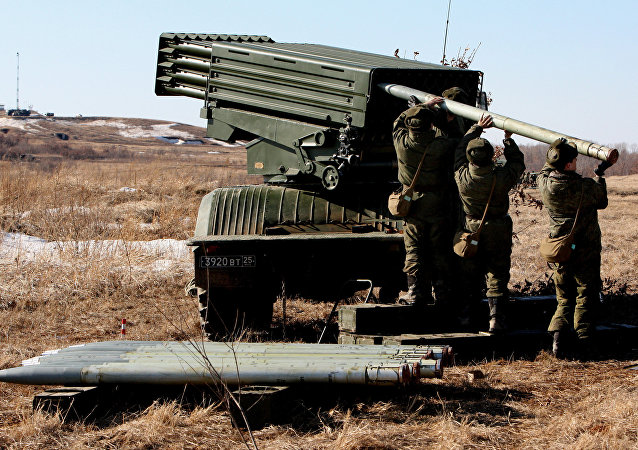 Troops load a Tornado artillery system during the artillery drill