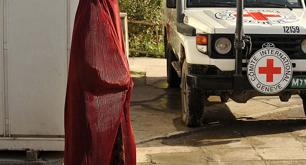 Afghan pedestrain walks past a vehicle at the International Committee for the Red Cross (ICRC) office in Kabul. (File)