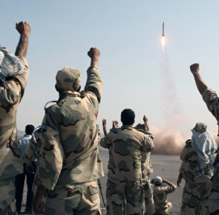 In this photo released by the Islamic Republic News Agency (IRNA), members of the Iranian Revolutionary Guard celebrate after launching a missile during their maneuver in an undisclosed location in Iran (File)
