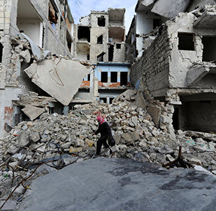 A man walks near damaged buildings in Aleppo, Syria January 30, 2017.