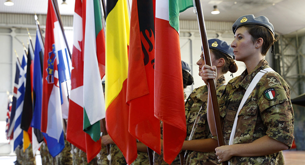 Soldiers line up holding flags of NATO member countries, during the opening ceremony of NATO Trident Juncture exercise 2015, in Trapani, Italy, Monday, Oct. 19, 2015
