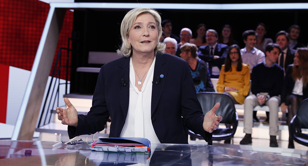 French presidential election candidate for the far-right Front National (FN) party Marine Le Pen speaks as she takes part in the show L'Emission politique, in the studios of French television channel France 2 in Saint-Cloud, west of Paris, on January 9, 2017