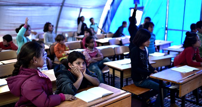 Syrian  children take lessons in a makeshift school tent in a refugee camp in the town of Suruc, Sanliurfa province (File)