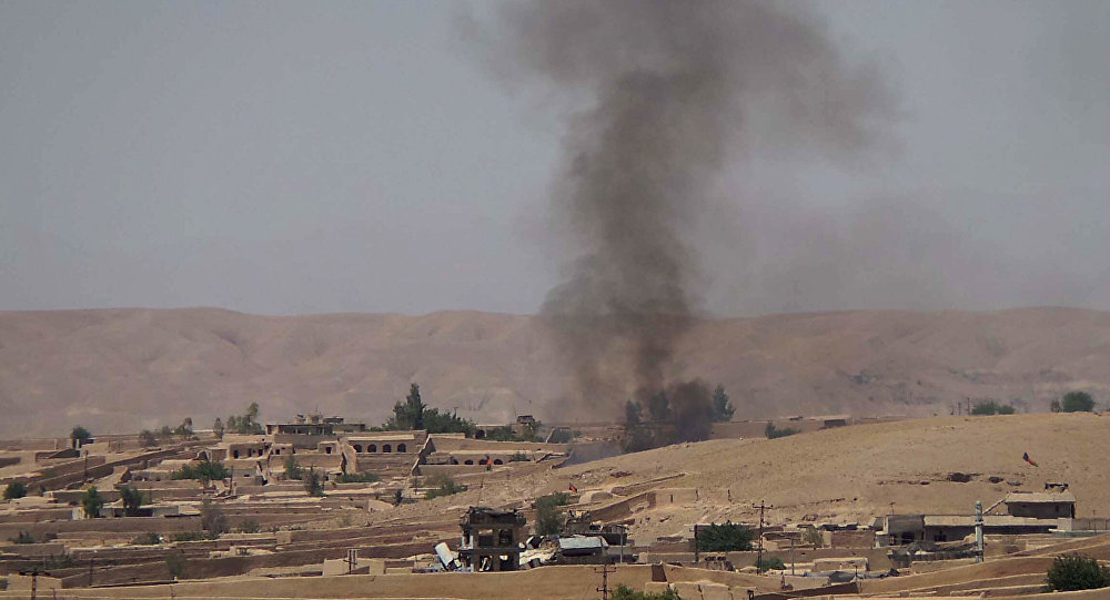 Smoke rises following fighting between the Afghan National Army and Taliban insurgents in the Sangin district of Helmand province (File)