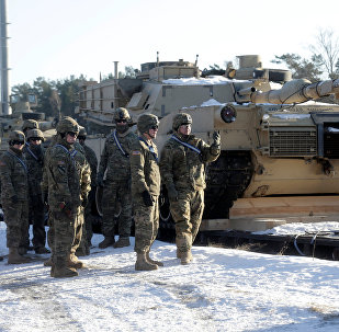 U.S. soldiers stand next to the M1 Abrams tanks that will be deployed in Latvia for NATO's Operation Atlantic Resolve in Garkalne, Latvia February 8, 2017