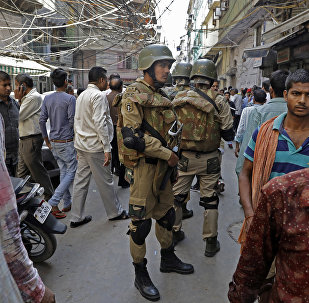Delhi Police SWAT team members stand near the site of an explosion in a market in New Delhi, India, Tuesday, Oct. 25, 2016