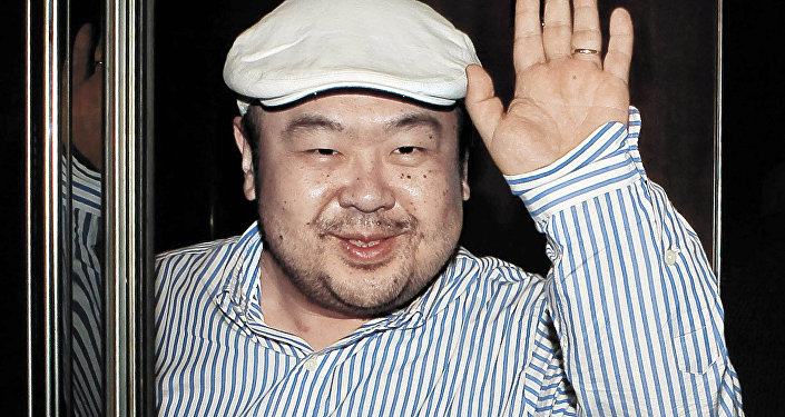 In this June 4, 2010 file photo, Kim Jong Nam, the eldest son of North Korean leader Kim Jong Il, waves after his first-ever interview with South Korean media in Macau, China