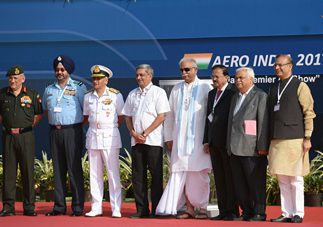 (R-L) Indian Defense Minister Manohar Parrikar, Indian Navy Chief Sunil Lanba, Indian Air Force Chief Birender Singh Dhanoa, and Indian Army Chief Bipin Rawat pose during the inaugural day of the 11th edition of 'Aero India', a biennial air show and aviation exhibition, in Bangalore on February 14, 2017