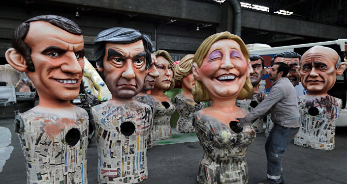 Giant figures of (L-R) Emmanuel Macron, head of the political movement En Marche !, or Onwards !, and candidate for the 2017 presidential election, Francois Fillon, former French prime minister, member of The Republicans political party and 2017 presidential candidate of the French centre-right, and French National Front leader Marine Le Pen, are seen during preparations for the carnival parade in Nice, France, February 2, 2017