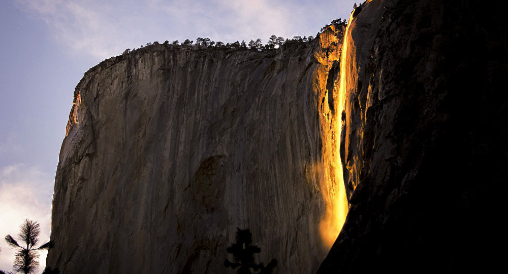 Yosemite National Park's firefall, an optical illusion that turns the water orange.