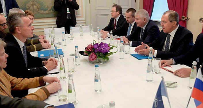 Russian Foreign Minister Lavrov, right, and NATO Secretary General Jens Stoltenberg, left, during their meeting at the 53rd Munich Security Conference
