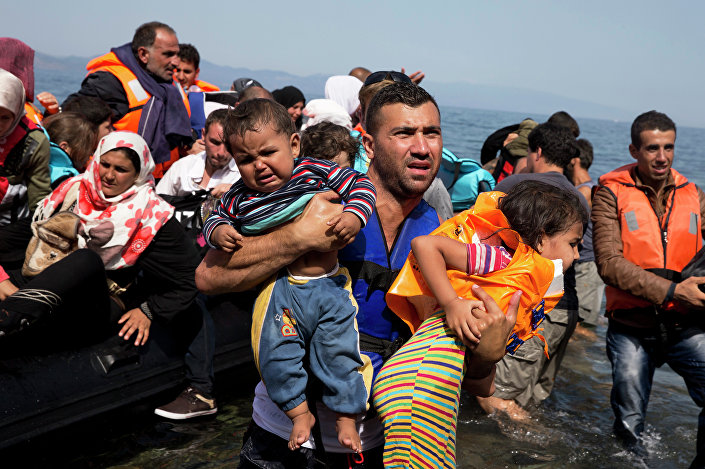 Syrian refugees arrive aboard a dinghy after crossing from Turkey to the island of Lesbos, Greece, Thursday, Sept. 10, 2015. The US is making plans to accept 10,000 Syrian refugees in the coming budget year