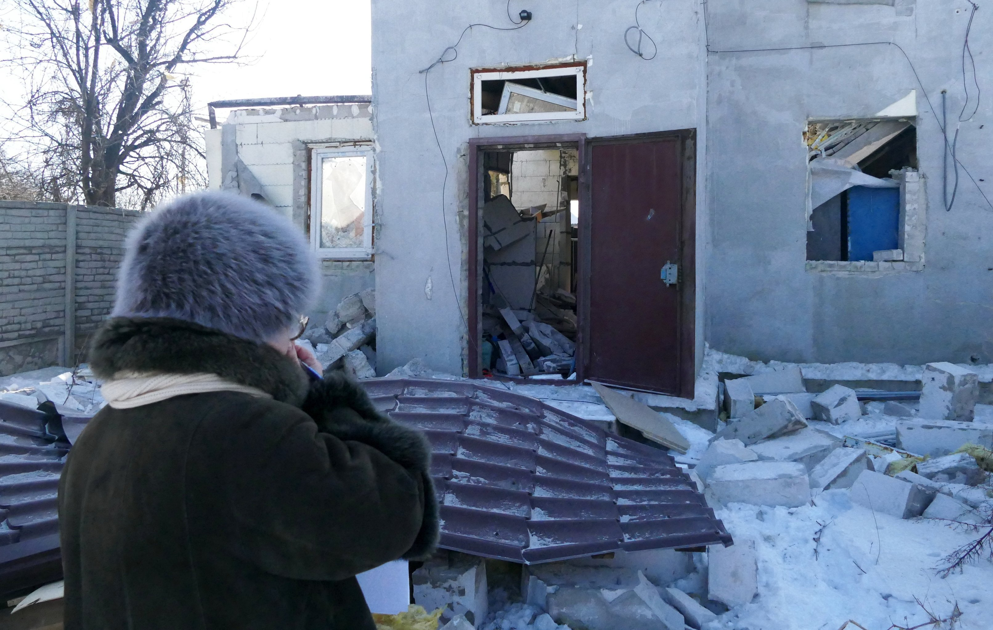 A woman by a house damaged by the shelling of the Ukrainian army in Makeevka, Donetsk Region. File photo