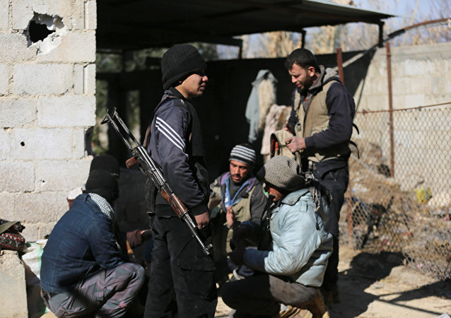 Fighters from the Jaish al-Islam (Islam Army), the foremost rebel group in Damascus province who fiercely oppose both the Syrian regime and the Islamic State group, gather inside a building on the frontline in the town of Bilaliyah, east of the capital Damascus, on February 4, 2017