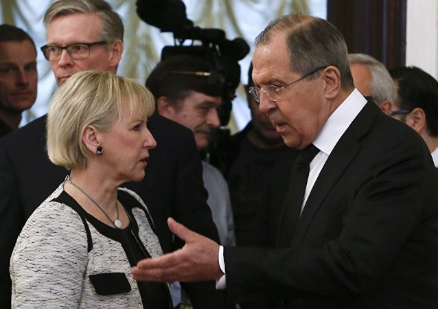 Russian Foreign Minister Sergei Lavrov (R) shows the way to his Swedish counterpart Margot Wallstrom during a meeting in Moscow, Russia, February 21, 2017