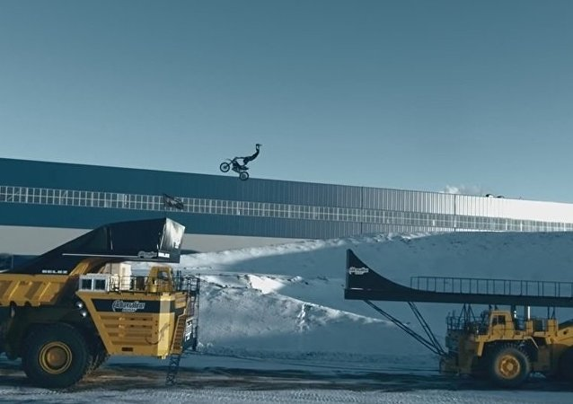 Biker Performs Breath-Taking Jump on the World's Largest Moving Truck