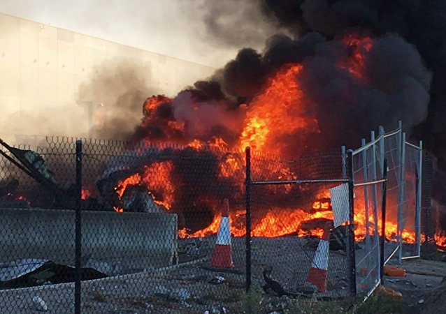 This frame grab taken from AFPTV of video received from Jordan Fouracre on February 21, 2017 shows smoke and flames after a twin-engined Beechcraft plane crashed into a shopping centre just after take-off from Essendon Fields airport near Melbourne
