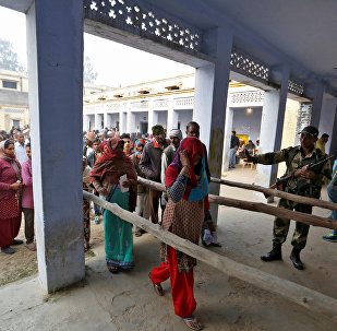 People queue to vote during the state assembly election, in the town of Deoband, in the state of Uttar Pradesh, India, February 15, 2017