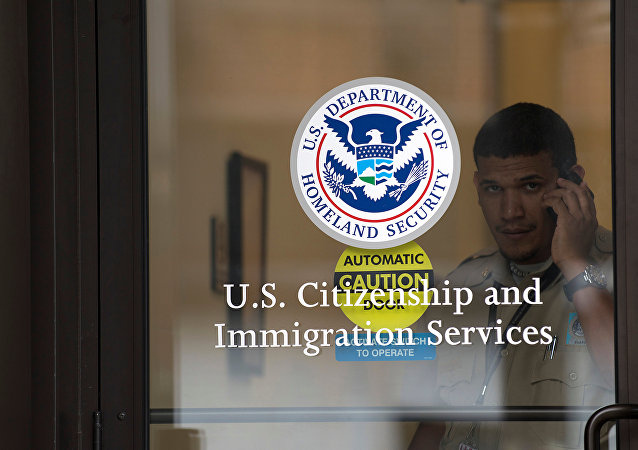 A security guard looks out of the U.S. Citizenship and Immigration Services offices in New York, U.S. (File)
