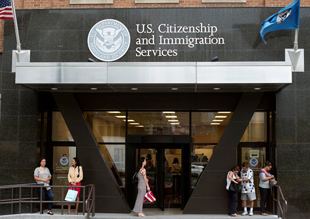 People stand on the steps of the U.S. Citizenship and Immigration Services offices in New York, U.S. (File)