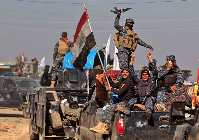 Iraqi security forces regroup in the village of al-Buseif, south of Mosul, during an offensive by Iraqi forces to retake the western side of the city from Islamic State (IS) group fighters on February 22, 2017