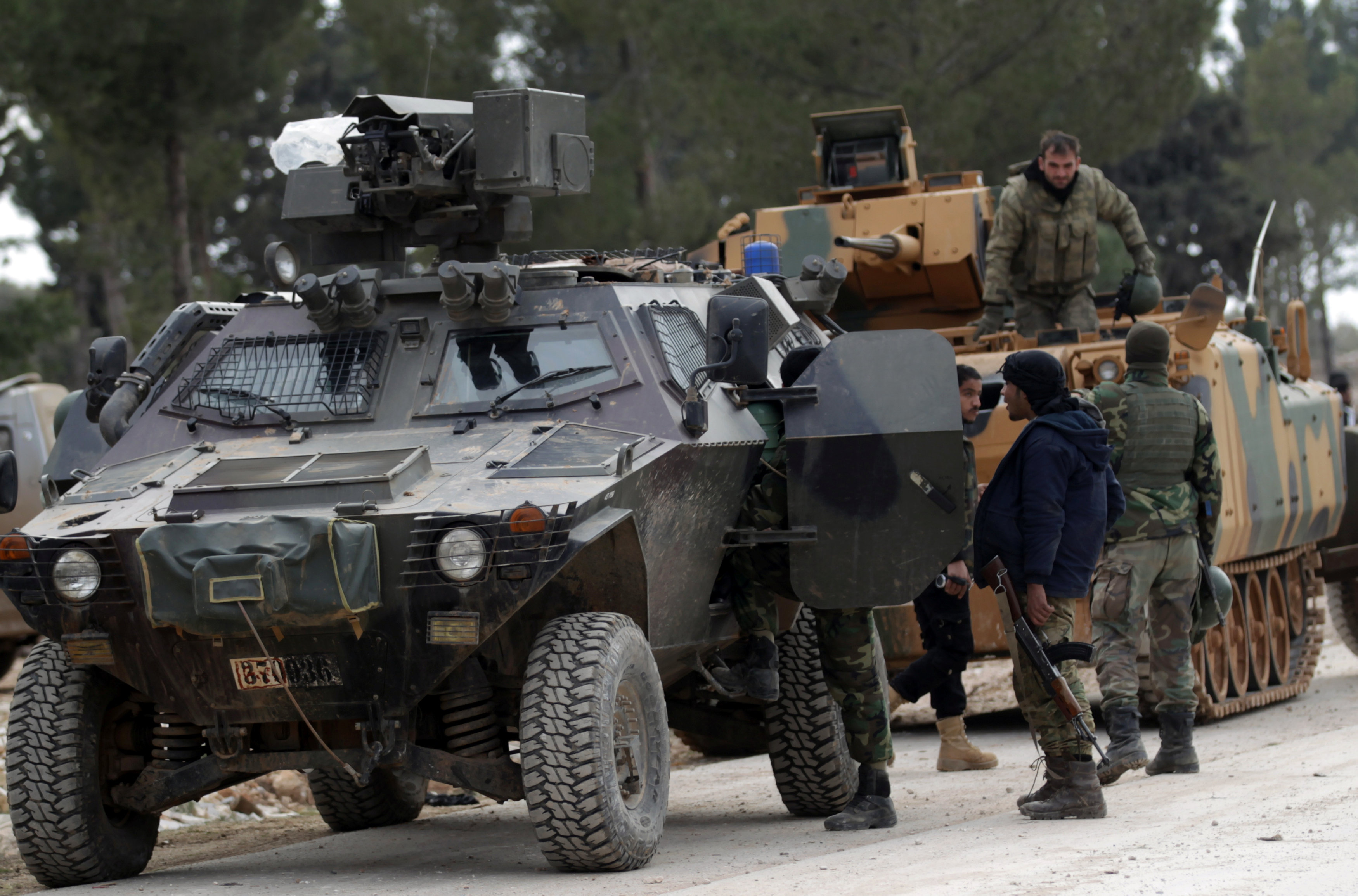 Turkish forces and members of the Free Syrian Army are seen at the al Baza'a village on the outskirts of al-Bab town in Syria