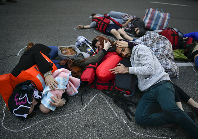 Demonstrators make a performance on the street during a protest in support of refugees and migrants entering Europe, in Pamplona, northern Spain