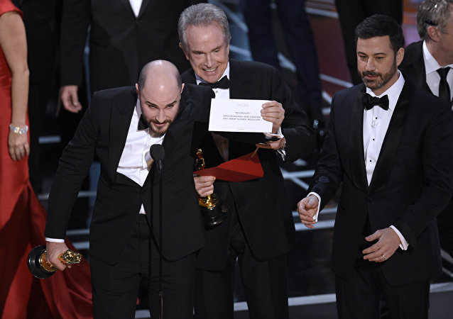 Jordan Horowitz, producer of La La Land, shows the envelope revealing Moonlight as the true winner of best picture at the Oscars on Sunday, Feb. 26, 2017, at the Dolby Theatre in Los Angeles