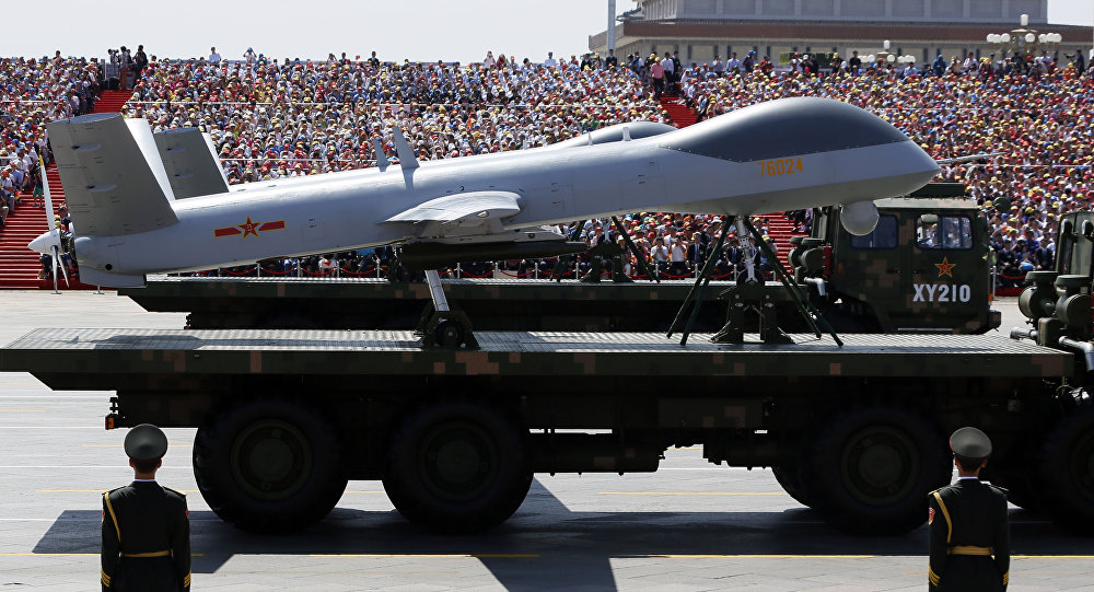 Military vehicles carry Wing Loong drones, a Chinese made medium-altitude long-endurance unmanned aerial vehicle, past spectators during a parade commemorating the 70th anniversary of Japan's surrender during World War II held in front of Tiananmen Gate in Beijing, Thursday, Sept. 3, 2015