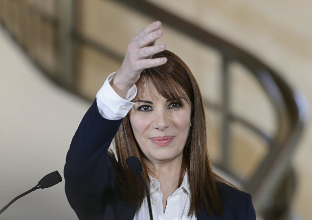 Members of the Syria's regime-tolerated opposition Randa Kassis gestures during a press conference following a new round of negotiations of peace talks on Syria at the United Nations Office in Geneva on March 23, 2016
