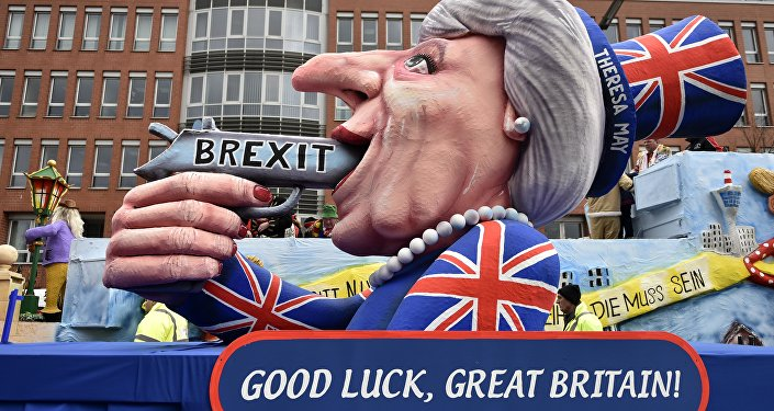 A carnival float depicts British Prime Minister Theresa May with a gun and the writing 'Brexit' on it prior to the traditional carnival parade in Duesseldorf, Germany, on Monday, Feb. 27, 2017.