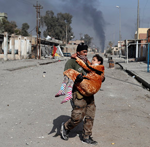 An Iraqi special forces soldier carries a woman injured during a battle between Iraqi forces and Islamic State fighters in Mosul, Iraq February 28, 2017