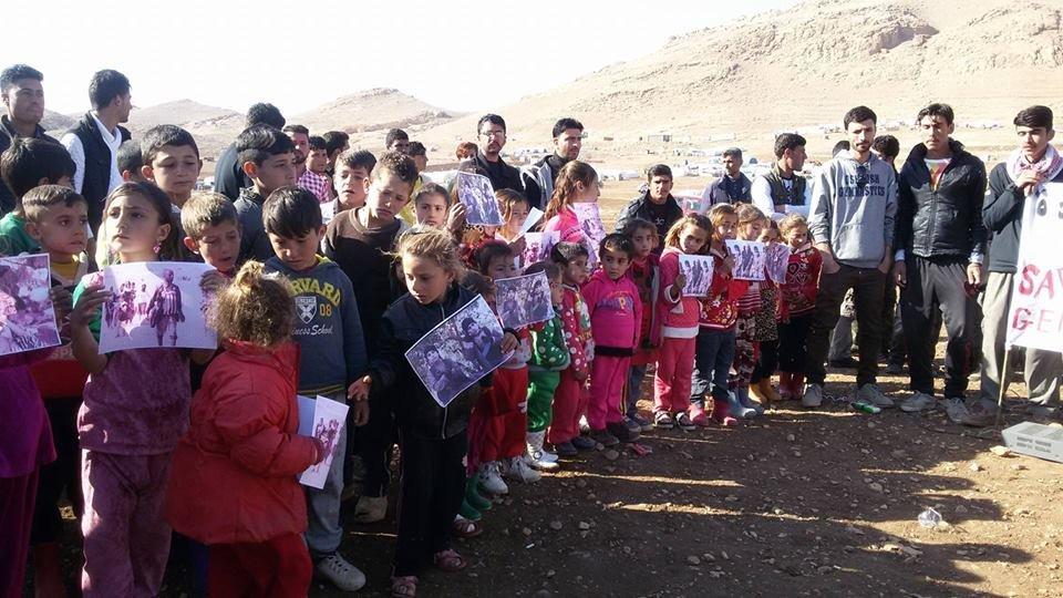 Yazidi rally at a refugee camp n Sinjar Mountains, Iraq
