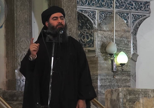 This July 5, 2014 photo shows an image grab taken from a propaganda video released by al-Furqan Media allegedly showing Daesh leader Abu Bakr al-Baghdadi, aka Caliph Ibrahim, adressing Muslim worshippers at a mosque in the militant-held northern Iraqi city of Mosul
