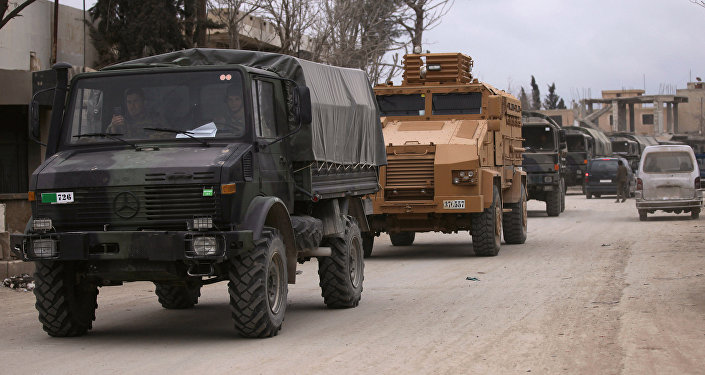 Turkish military vehicles drive in the Syrian rebel-held town of al-Rai, as they head towards the northern Syrian town of al-Bab, Syria March 2, 2017