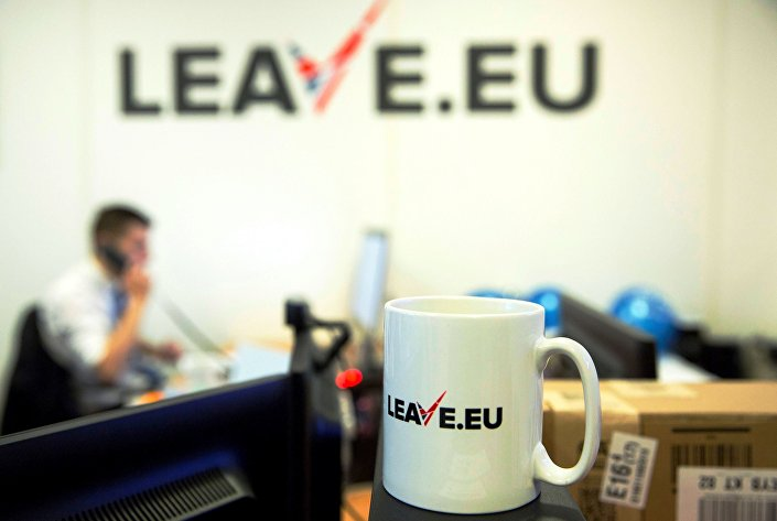 A worker answers a telephone in the office of Brexit group pressure group Leave.eu in London, Britain.