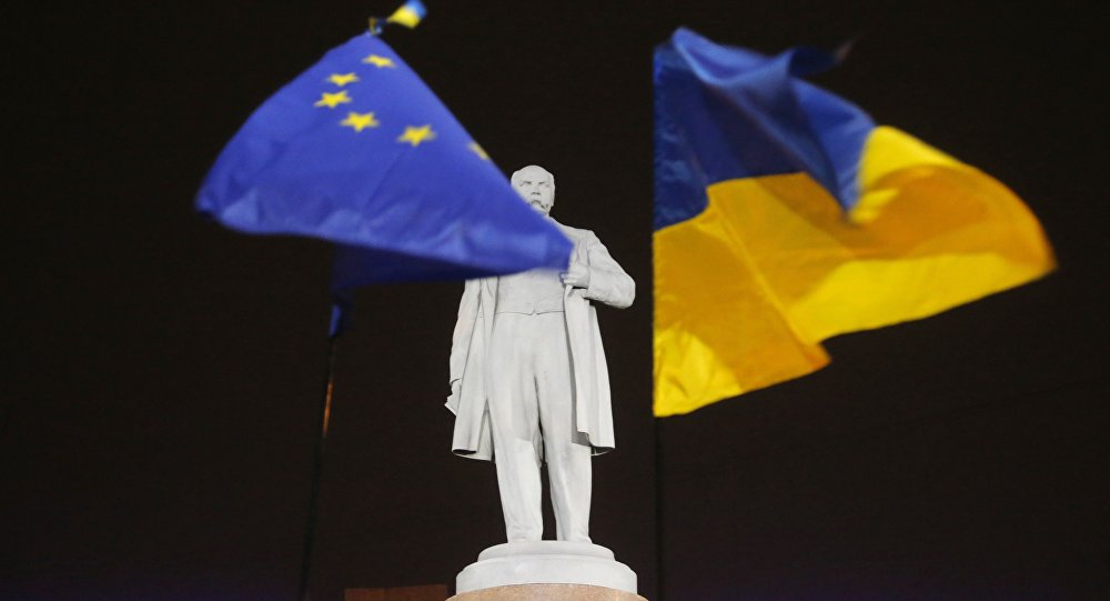 In this Thursday, Dec. 5, 2013 photo opposition protesters holds hold the EU and Ukrainian, right, flags around a monument to Ukrainian poet Taras Shevchenko in downtown Donetsk, eastern Ukraine.