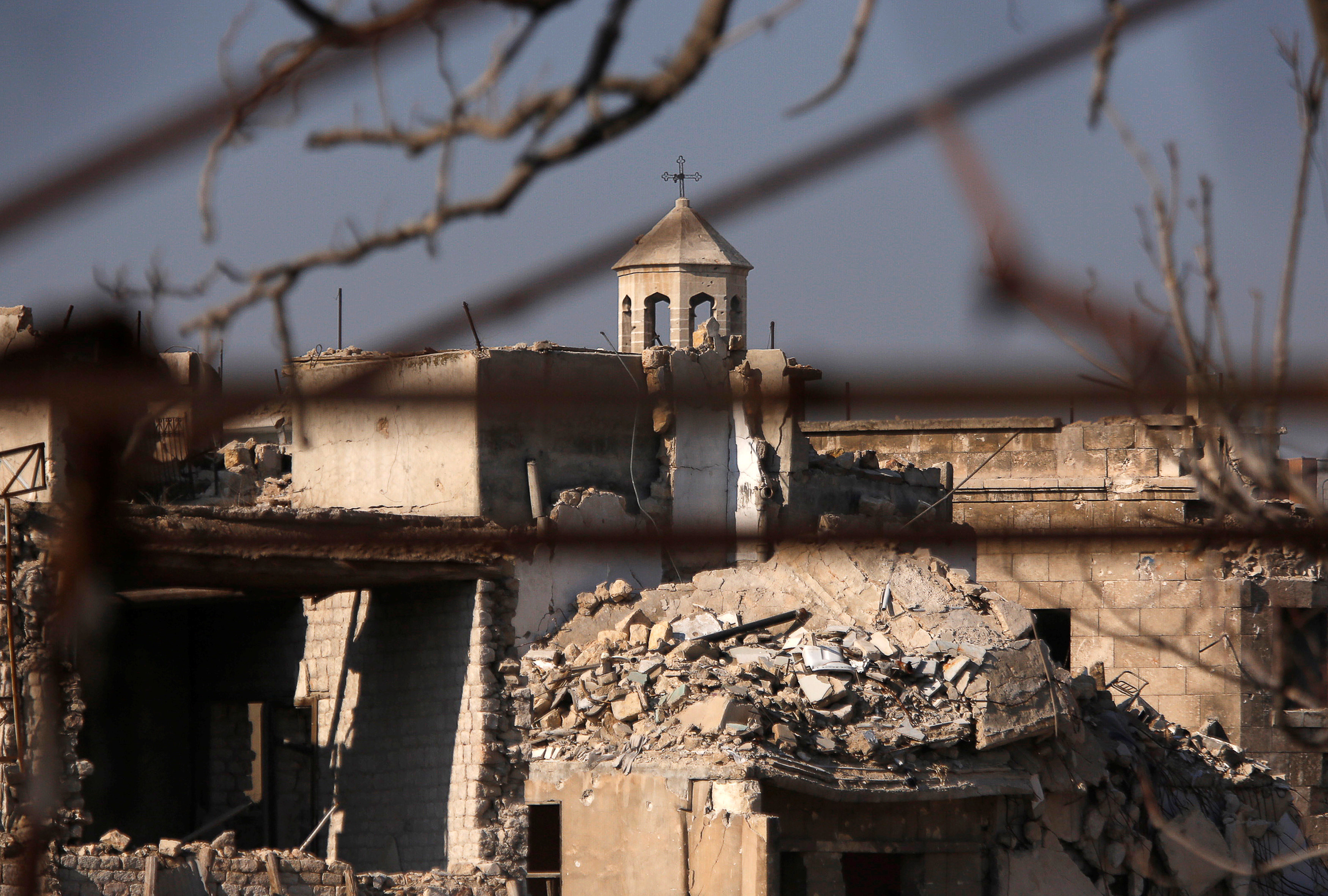 A part of a church is seen amid the damage in the government-controlled area of the Old City of Aleppo, Syria December 10, 2016