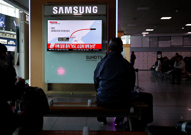 Passengers watch a television broadcasting a news report on North Korea firing ballistic missiles, at a railway station in Seoul, South Korea, March 6, 2017.